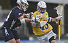 Ryan Tierney #43 of Hofstra University, right, maneuvers through the Monmouth defense during an NCAA men's lacrosse game at Shuart Stadium in Hempstead, NY on Wednesday, March 14, 2018. He scored three goals in Hofstra's 7-6 win.