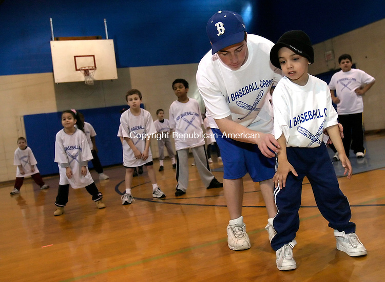 WATERBURY, CT. 01 FEBRUARY 2006-020506BZ02- <br /> <br /> Instructor Dan Saucier helps Ilyhas Morales, 4, of Waterbury, during the first week of winter baseball camp at the Anderson Boys Club in Waterbury Sunday afternoon.<br /> Jamison C. Bazinet / Republican-American