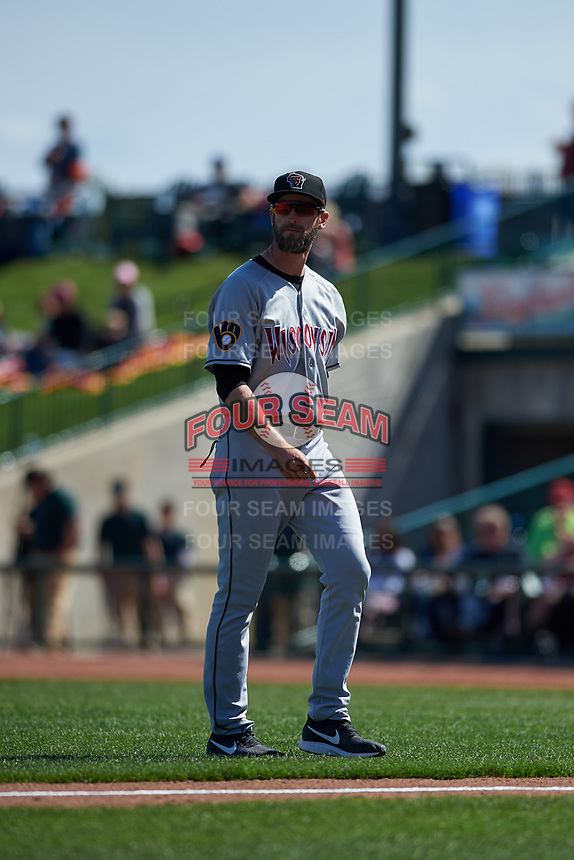 Wisconsin Timber Rattlers pitching coach Jim Henderson (29) walks off the field after a visit to the mound during a Midwest League game against the Great Lakes Loons at Dow Diamond on May 4, 2019 in Midland, Michigan. Great Lakes defeated Wisconsin 5-1. (Zachary Lucy/Four Seam Images)