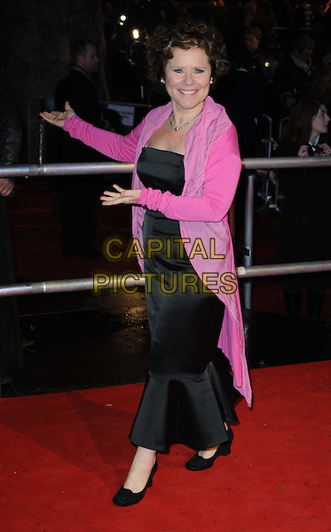 "IMELDA STAUNTON.""Harry Potter And The Deathly Hallows: Part 1""  World Film Premiere, .Empire cinema Leicester Square and Odeon Leicester Square, London, England, UK, 11th November 2010..full length long maxi dress pink cardigan hands gesture  black .CAP/WIZ.© Wizard/Capital Pictures."