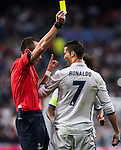 Cristiano Ronaldo of Real Madrid reacts as the referee Ruddy Buquet (l) shows him a yellow card during the 2016-17 UEFA Champions League match between Real Madrid and Legia Warszawa at the Santiago Bernabeu Stadium on 18 October 2016 in Madrid, Spain. Photo by Diego Gonzalez Souto / Power Sport Images