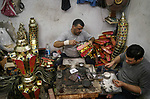 "A picture taken on April 26, 2018 show Egyptian men manufactur traditional lanterns known in Arabic as ""Fanous"", ahead of the holy Muslim month of Ramadan in Cairo, Egypt. Ramadan is sacred to Muslims because it is during that month that tradition says the Koran was revealed to the Prophet Mohammed. The fast is one of the five main religious obligations under Islam. Muslims around the world will mark the month, during which believers abstain from eating, drinking, smoking and having sex from dawn until sunset. Photo by Amr Sayed"