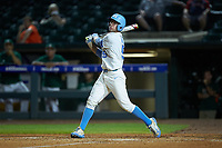 Brian Miller (5) of the North Carolina Tar Heels follows through on his swing against the Miami Hurricanes in the second semifinal of the 2017 ACC Baseball Championship at Louisville Slugger Field on May 27, 2017 in Louisville, Kentucky. The Tar Heels defeated the Hurricanes 12-4. (Brian Westerholt/Four Seam Images)