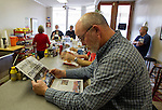 "MIDLAND CITY, AL- FEBRUARY 5:  Michael Duke reads the Dothan Eagle newspaper with the headline ""Ethan Rescued"" as he waits to eat lunch inside Marshall Sandwich Shop in the small downtown area of Midland City, Alabama February 5, 2013.  The Midland City area has been gripped by a hostage situation when 5 year-old named Ethan was abducted from a school bus and held hostage for 6 days before being rescued when the FBI stormed the bunker killing suspect, Jimmy Lee Dykes.   (Photo by Mark Wallheiser/Getty Images)"