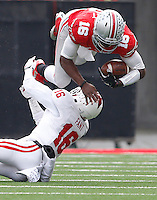 Ohio State Buckeyes quarterback J.T. Barrett (16) goes for yardage against Indiana Hoosiers cornerback Rashard Fant (16) in the 1st quarter at Ohio Stadium Nov. 22, 2014.(Dispatch photo by Eric Albrecht)