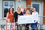 Rachel O'Brien and her family presented a cheque of €4200 Acquired Brain Injury Ireland in Castleisland on Tuesday front row l-r: Aoibhin, Carol and Roisin Manning, Michelle and Rachel O'Brien, Gemma Smith ABI Ireland Community Rehabilotaion Assiatant. Back row: Ria and Emer Harty and Lisa Spogler Local Service Manager