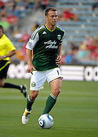 Portland midfielder Jack Jewsbury (13) dribbles the ball.  The Portland Timbers defeated the Chicago Fire 1-0 at Toyota Park in Bridgeview, IL on July 16, 2011.