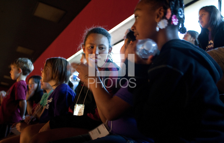 Stanford, CA -- January 28, 2012: Margani Hing-Glover with Bay Area Women Sports Initiative (BAWSI) girls and their families in the stands during  Saturday afternoon as part of Stanford vs. Cal Women's Basketball game at Maples Pavilion at Stanford.<br /> <br /> Stanford defeat Cal 74-71 in overtime.