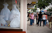 A store front advertises children's clothing along Main Street in downtown McAllen, Texas, Sunday, April 4, 2010. Downtown McAllen stores don't sell designer or name brand items, but still reach a wide customer base for McAllen residents and visiting Mexican tourists. ...PHOTO/ Matt Nager