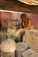 Mumbai, a happy worker in the Banganga area, bakery