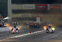 Sep 28, 2013; Madison, IL, USA; NHRA top fuel dragster driver Doug Kalitta (left) races alongside Bob Vandergriff Jr during qualifying for the Midwest Nationals at Gateway Motorsports Park. Mandatory Credit: Mark J. Rebilas-