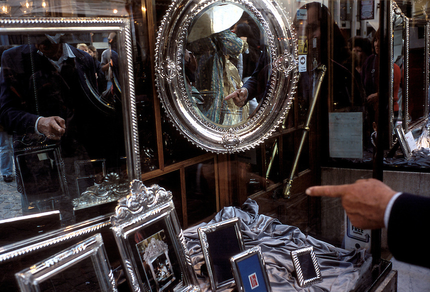 Mirrors draw the curious to an antique shop window in San Telmo, a neighborhood of Buenos Aires, Argentina.