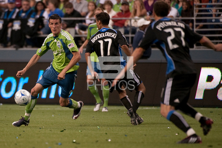 Sebastien Le Toux (l) maneuvers against Chris Wondolowski (c) and Aaron Pitchkolan (r) in the Seattle Sounders 2-1 win against San Jose Earthquake on Saturday, June 13, 2009 at Quest Field in Seattle, WA.