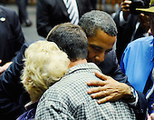 "United States President Barack Obama hugs the family of Tucson shooting victim Dorwin Stoddard at the event ""Together We Thrive: Tucson and America"" honoring the January 8 shooting victims at McKale Memorial Center on the University of Arizona campus on Wednesday, January 12, 2011 in Tucson, Arizona. The memorial service is in honor of victims of the mass shooting at a Safeway grocery store that killed six and injured at least 13 others, including U.S. Representative Gabrielle Giffords (Democrat of Arizona), who remains in critical condition after being shot in the head. Among those killed were U.S. District Judge John Roll, 63; Giffords' director of community outreach, Gabe Zimmerman, 30; and 9-year-old Christina Taylor Green. .Credit: Kevork Djansezian / Pool via CNP"