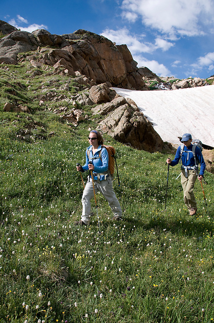 couple, hiking, (MR), hike, alpine, snow field, nature, meadow, high elevation, below Lake Dunraven, recreation, outdoors, activity, summer, August, morning, Rocky Mountain National Park, Colorado, USA