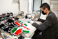 A worker sewing masks with the Italian flag colors<br /> Rome May 8th 2020. During the Coronavirus pandemic, many factories were reconverted creating masks. Dress Code, a clothes factory based in the outskirts of Rome,  was one of the first companies that changed its production, to respond to all the requests. Now they provide masks for Police, Finance Guard and traffic wardens as well that for citizens, and have donated many masks to associations.<br />  Photo Samantha Zucchi Insidefoto