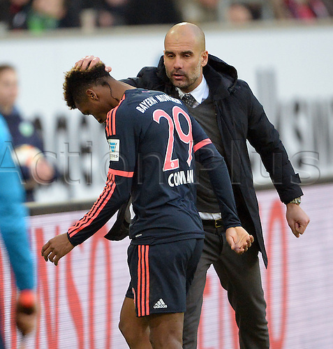 27.02.2016. Wolfsburg, Germany.  Munich coach Pep Guardiola (r) substitutes Kingsley Coman during the German Bundesliga football match between VfL Wolfsburg and FC Bayern Munich at the Volkswagen-Arena in Wolfsburg, Germany