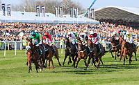 14h April 2018, Aintree Racecourse, Liverpool, England; The 2018 Grand National horse racing festival sponsored by Randox Health, day 3; Horses run towards the water jump in The Grand National