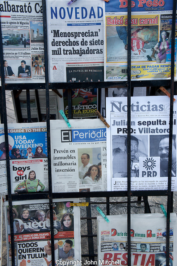 Spanish language Mexican newspapers at a news stand in downtown, Cancun, Quintana Roo, Mexico.