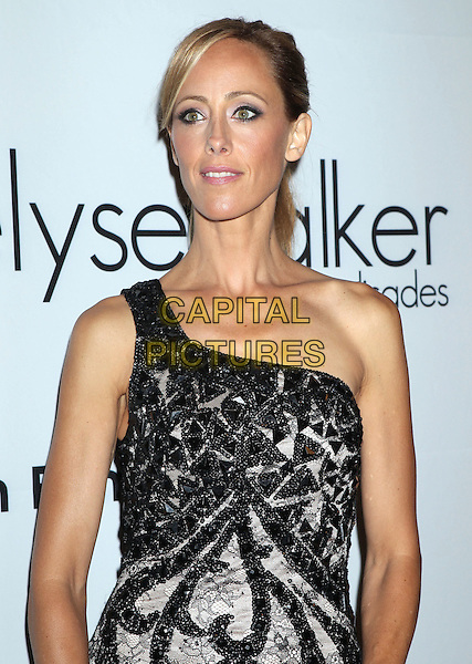 Kim Raver.2011 Pink Party held at Drai's Hollywood, Hollywood, California, USA..September 10th, 2011.half length black one shoulder dress pattern lace beige .CAP/ADM/RE.©Russ Elliot/AdMedia/Capital Pictures.