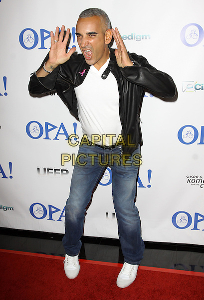 "ALKI DAVID.Virtual Premiere And Simulcast Of ""Opa!"" held At The Mann Chinese 6 Theaters, Hollywood, California, USA..October 5th, 2009.full length white top black leather jacket suit  jeans denim mouth open hands gesture funny .CAP/ADM/KB.©Kevan Brooks/AdMedia/Capital Pictures."