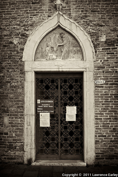 Wrought-iron gate and Venetian Gothic element are part of the charm of this doorway in Venice.