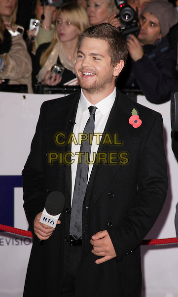 JACK OSBOURNE .The National Television Awards, Royal Albert Hall, London, England..October 31st, 2007.TV half length black suit jacket beard stubble facial hair poppy microphone.CAP/ROS.©Steve Ross/Capital Pictures