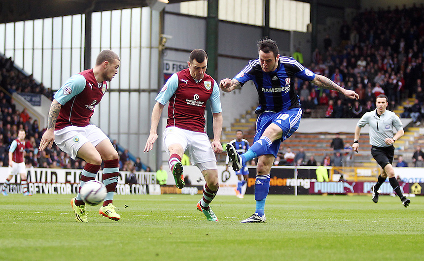Middlesbrough&rsquo;s Lee Tomlin with a shot on goal early in the match<br /> <br /> Photo by Rich Linley/CameraSport<br /> <br /> Football - The Football League Sky Bet Championship - Burnley v Middlesbrough - Saturday 12th April 2014 - Turf Moor - Burnley<br /> <br /> &copy; CameraSport - 43 Linden Ave. Countesthorpe. Leicester. England. LE8 5PG - Tel: +44 (0) 116 277 4147 - admin@camerasport.com - www.camerasport.com
