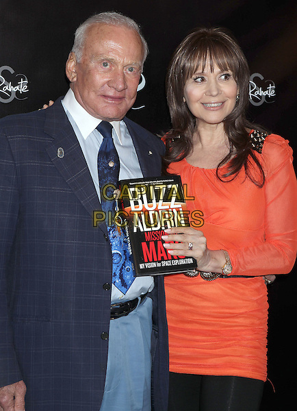 Buzz Aldrin, Dr. Ava Cadell.Courtney Stodden attends the Dr. Ava Cadells Sizzling Sexy Summer of 2013 Seminar at Shekhar Rahate Haute Couture Showroom, West Hollywood, California, USA, 16th May 2013..half length blue jacket tie trousers orange dress holding book .CAP/ADM/RE.©Russ Elliot/AdMedia/Capital Pictures