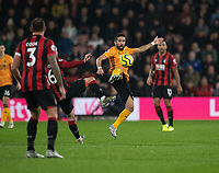Wolverhampton Wanderers' Joao Moutinho (centre) battles for possession with Bournemouth's Lewis Cook<br /> <br /> Photographer David Horton/CameraSport<br /> <br /> The Premier League - Bournemouth v Wolverhampton Wanderers - Saturday 23rd November 2019 - Vitality Stadium - Bournemouth<br /> <br /> World Copyright © 2019 CameraSport. All rights reserved. 43 Linden Ave. Countesthorpe. Leicester. England. LE8 5PG - Tel: +44 (0) 116 277 4147 - admin@camerasport.com - www.camerasport.com