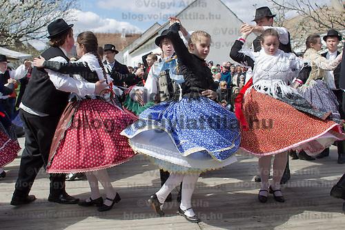 Folk dancers perform during an easter celebration in the Skanzen open air folk museum in Szentendre, Hungary on April 08, 2012. ATTILA VOLGYI