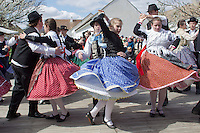 Folk dancers perform during an easter celebration in the Skanzen open air folk museum in Szentendre, Hungary on April 08, 2012. ATTILA VOLGYI