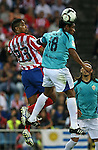 Atletico de Madrid's Cleber Santana (l) and Almeria's Santi Acasiete during La Liga match. September 24 2009. .(ALTERPHOTOS/Acero).