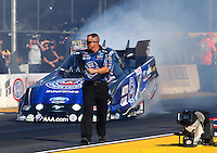 Jul. 25, 2014; Sonoma, CA, USA; A crew member runs beside NHRA funny car driver Robert Hight during qualifying for the Sonoma Nationals at Sonoma Raceway. Mandatory Credit: Mark J. Rebilas-