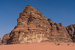 Desert sand and mountains in the Wadi Rum Protected Area, a UNESCO World Heritage Site.  Um Sahn sandstone .  Hashemite Kingdom of Jordan.