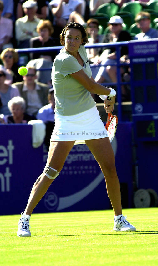 Photo. Rene Solari..19/6/01  .Eastbourne Day 2. American Lindsay Davenport lines up her shot against Frence Anne-Gaelle Sidot....