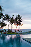 The lower pool which is close to the ocean at sunset at the Andaz hotel in Wailea, Maui, Hawaii