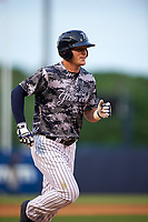 Tampa Yankees center fielder Trey Amburgey (17) rounding the bases after hitting a home run in the bottom of the fourth inning during a game against the Bradenton Marauders on April 15, 2017 at George M. Steinbrenner Field in Tampa, Florida.  Tampa defeated Bradenton 3-2.  (Mike Janes/Four Seam Images)