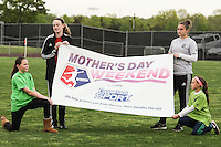 Piscataway, NJ, May 7, 2016.  Local girls hold a Coppertone banner during the pre-game festivities before the game between Sky Blue FC and the Western New York Flash. The Western New York Flash defeated Sky Blue FC, 2-1, in a National Women's Soccer League (NWSL) match at Yurcak Field.