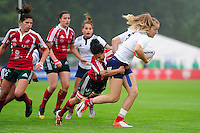 Johana Grisez of France takes on the Portugal defence. FISU World University Championship Rugby Sevens Women's Semi Final between France and Portugal on July 9, 2016 at the Swansea University International Sports Village in Swansea, Wales. Photo by: Patrick Khachfe / Onside Images