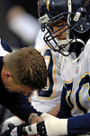 3 December 2006: San Diego Chargers offensive guard Shane Olivea is taped up prior to a game against the Buffalo Bills at Ralph Wilson Stadium in Orchard Park, New York. The Charges defeated the Bills 24-21. Mandatory Photo Credit: Ed Wolfstein Photo<br />