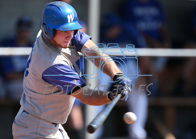 Corey Pool gets a hit for the Wildcats during the alumni game at Western Nevada College in Carson City, Nev., on Saturday, Sept. 7, 2013. The Wildcats defeated the Alumni 7-1.  <br /> Photo by Cathleen Allison/Nevada Photo Source