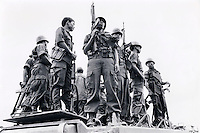 Janary and February 1986 were memorable days in the Philippines. The fall of dictator Ferdinand Marcos and the rise of the first so called democraticly chosen President Cory Aquino. Helped by the massive public support of People Power.<br /> Last stand of Marcos troops before his fall.
