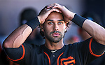 Giants' Angel Pagan walks through the dugout after an at bat in a spring training game against the Seatle Mariners in Peoria, Ariz., on Wednesday, March 16, 2016. <br />