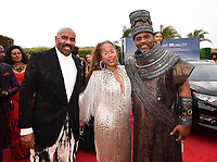 SANTA MONICA - JUNE 1: Steve Harvey, wife Marjorie Harvey, and Richard Lawson attend the 3rd Annual Wearable Art Gala at Barker Hangar on June 1, 2019 in Santa Monica, California. (Photo by Frank Micelotta/PictureGroup)