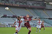 16th July 2020; Olympic Grande Torino Stadium, Turin, Piedmont, Italy; Serie A Football, Torino versus Genoa; Andrea Belotti of Torino FC has an attempt at goal as Davide Biraschi of Genoa FC challenges