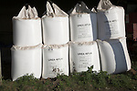 Bags of granulated urea fertiliser in a barn Sutton, Suffolk, England