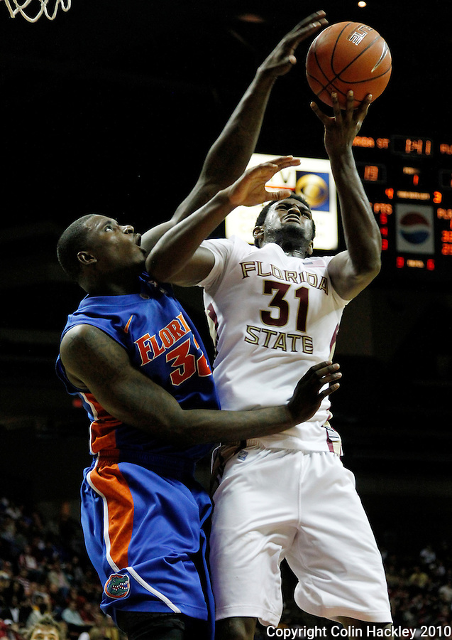 TALLAHASSEE, FL 09-FSU-UF MBB10 CH-Florida State's  Chris Singleton has a shot blocked by Florida's Vernon Macklin during first half action Sunday at the Donald L. Tucker Center in Tallahassee...COLIN HACKLEY PHOTO