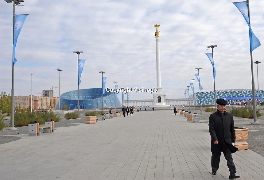 A man walks along the main boulevard in Astana, the capitol of Kazakstan.