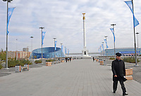 A man walks along the main boulevard in Astana, the capitol of Kazakstan.